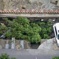 Photos: 成都 暴風雨で地面が陥没した駐車場 (3)