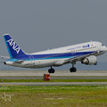 写真: ANA機離陸